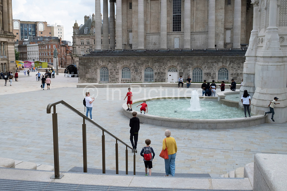 Scene at the newly renovated Chamberlain Square on 3rd August 2021 in Birmingham, United Kingdom. Chamberlain Square or Chamberlain Place is a public square in central Birmingham, England, named after statesman and notable mayor of Birmingham, Joseph Chamberlain. The Victorian square was drastically remodelled in the 1970s, with most of the Victorian buildings demolished. Re-landscaping occurred most recently when the square was closed to the public for five years until March 2021 for remodelling as part of the Paradise scheme.