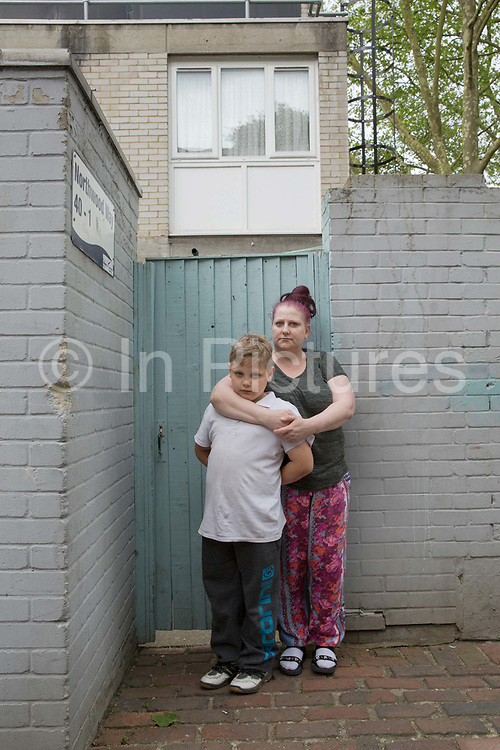 A family on Central Hill Estate on 17th May 2016 in South London, United Kingdom. Central Hill is a low-rise estate of more than 450 homes in Crystal Palace in South London and has been recommended for demolition under Lambeth Council estate regeneration plan. The housing scheme, built between 1966 and1974, was designed by Rosemary Stjernstedt under Lambeth Council's director of architecture, Ted Hollamby.