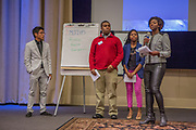 Purchase, NY – 31 October 2014. The team from Mamaroneck High School giving their presentation. (Left to right: Kennedy Whittington-Cooper, Emmanuel Rawlings, Vanessa  Pierre, Ittai Rosales.) The Business Skills Olympics was founded by the African American Men of Westchester, is sponsored and facilitated by Morgan Stanley, and is open to high school teams in Westchester County.