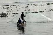 Thursday 14th August 2014: Fishermen cast a net in the Fort Kochi area.