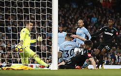 Manchester City's Nicolas Otamendi (centre) scores his side's first goal of the game during the Premier League match at the Etihad Stadium, Manchester.