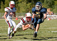 Bow's Nick Lulka can't catch Steven's quarterback Logan Batchelder as he dives into the endzone to score during the first half of NHIAA Division V football Saturday afternoon.  (Karen Bobotas/for the Concord Monitor)