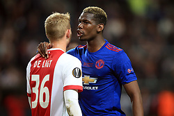 24 May 2017 - UEFA Europa League Final - Ajax v Manchester United - Matthijs de Ligt of Ajax whispers to  Paul Pogba of Manchester United - Photo: Marc Atkins / Offside.