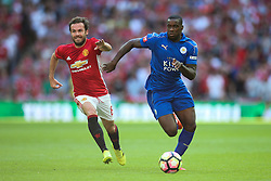 Jeffrey Schlupp of Leicester City under pressure from Juan Mata of Manchester United - Mandatory byline: Jason Brown/JMP - 07966386802 - 07/08/2016 - FOOTBALL - Wembley Stadium - London, England - Leicester City v Manchester United - FA Community Shield
