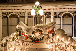 """""""Christmas Wreath in Truckee"""" - Photograph of a snow covered Christmas wreath and lights in Downtown Truckee, California."""