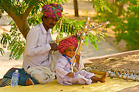 Father and son playing instruments near the Jaswant Thada (Royal Cenotaph), Jodhpur, Rajasthan, India