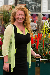 © Licensed to London News Pictures. 19/05/2014. London, England. Gardener and TV presenter Charlie Dimmock at the Just Airplants stand in partnership with Dreamflight.  Press Day at the RHS Chelsea Flower Show. On Tuesday, 20 May 2014 the flower show will open its doors to the public.  Photo credit: Bettina Strenske/LNP