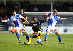 Mansfield Town's Anthony Howell battles for the ball with Bristol Rovers' Ollie Clarke and Bristol Rovers' Seanan Clucas - Photo mandatory by-line: Joe Meredith/JMP - Mobile: 07966 386802 03/05/2014 - SPORT - FOOTBALL - Bristol - Memorial Stadium - Bristol Rovers v Mansfield - Sky Bet League Two