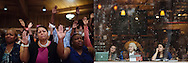 LEFT:  Members of the community gather on Tuesday, Aug. 12, 2014, at Greater St. Mark Church in St. Louis County, Missouri. The gathering was in response to the fatal police shooting of 18-year-old Michael Brown in Ferguson, Missouri.<br /> <br /> RIGHT:  Patrons watch from a coffee shop as protesters demonstrate on Sunday, Nov. 16, 2014, in St. Louis. The event marked the 100 days since Michael Brown was fatally shot by Ferguson police Officer Darren Wilson.