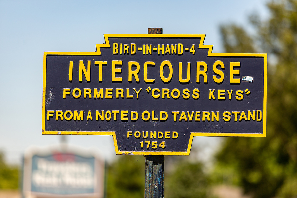 Intercourse, PA, USA - June 18, 2016: Old bue Intercourse road sign, identifying the Lancaster County Community as formerly Cross Keys