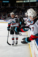 KELOWNA, BC - FEBRUARY 17: Alex Swetlikoff #17 of the Kelowna Rockets leads his line to the bench to celebrate a second period goal against the Calgary Hitmen at Prospera Place on February 17, 2020 in Kelowna, Canada. (Photo by Marissa Baecker/Shoot the Breeze)