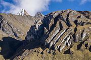 Nevado Jirishanca Chico (5446 m). Geology: Cordillera Huayhuash is comprised of uplifted sedimentary sea floor rocks (quartzite, limestone, slate) with a base of granodiorite. Day 3 of 9 days trekking around the Cordillera Huayhuash in the Andes Mountains, Peru, South America.