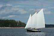 Eggemoggin Reach, ME - 9 August 2014. A schooner sailing off of Torrey Island, Egggemoggin Reach, neaer Center Harbor.