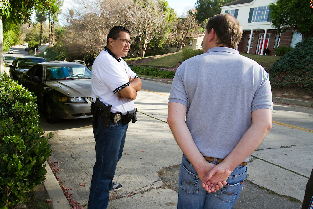 UCLA professor David Jentsch chats with the UCLA security detail assigned to his home to prevent animal rights activists from getting within 150 feet of his home.