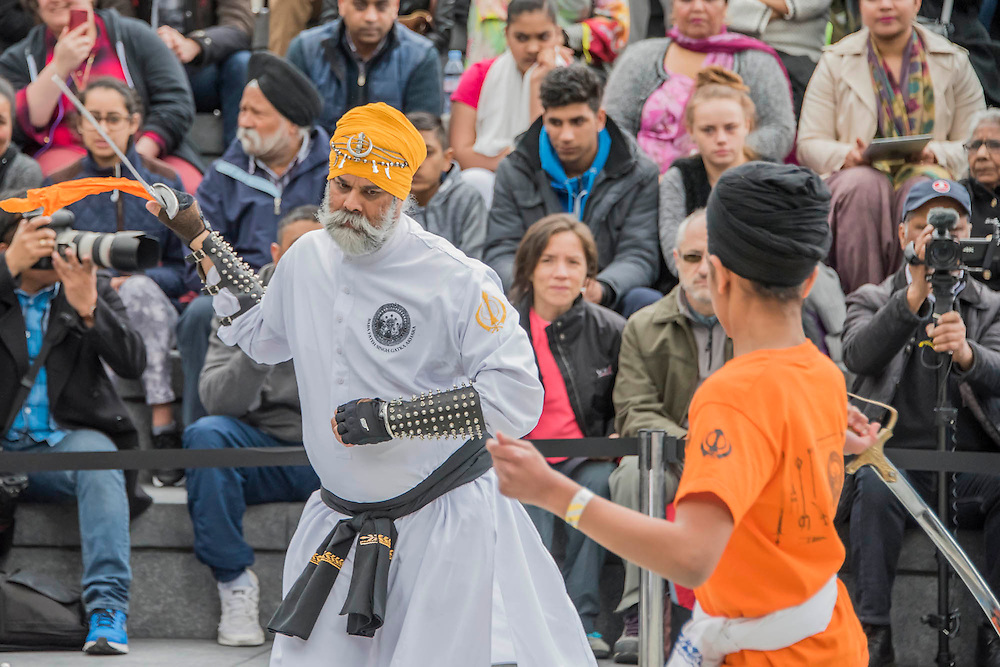 Crowds watch a Gatka  display (martial arts) - The Vaisakhi Festival at City Hall and More London Riverside on Saturday 9 April, celebrating the holiest day of the Sikh calendar. This year's celebrations will take place just before the official Vaisakhi festival on 13 April which commemorates the beginning of Sikhism as a collective faith and London's celebrations are an opportunity for people from all communities, faiths and backgrounds to experience a festival that is celebrated by over 126,000 Sikhs who live in the capital and 20 million people across the world.