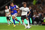 Derby County defender Jayden Bogle (37) holds off Ipswich Town forward Kayden Jackson (9) during the EFL Sky Bet Championship match between Derby County and Ipswich Town at the Pride Park, Derby, England on 21 August 2018.