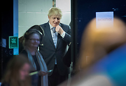 © Licensed to London News Pictures. 11/12/2019. London, UK. A pensive Boris Johnson waits backstage before speaking at his final election rally in the Copper Box Arena at the Queen Elizabeth Olympic Park. Supporters and party workers have gathered to hear The Prime Minister speak on the last day of campaigning. Voting in the general election will start at 7am tomorrow. Photo credit: Peter Macdiarmid/LNP