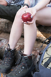 Close-up of woman holding a red apple, Bavaria, Germany
