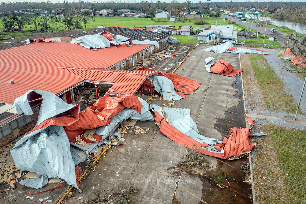 The metal roof of Upper Little Caillou Elementary is left twisted across the parking lot after Catagory 4 Hurricane Ida passed through Terrebonne Parish with winds up to 150 mph.