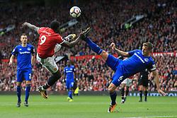 17th September 2017 - Premier League - Manchester United v Everton - Romelu Lukaku of Man Utd battles acrobatically with Phil Jagielka of Everton - Photo: Simon Stacpoole / Offside.