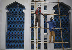 May 24, 2019 - Dhaka, bangladesh - Two worker polish on wood broad as they prepare for Eid-Al Fitr after the end of the month of Ramadan at the National Eidga (place of worship) in Dhaka. (Credit Image: © MD Mehedi Hasan/ZUMA Wire)