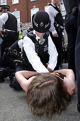 © licensed to London News Pictures. LONDON, UK  30/06/2011. Police us a filter cordon to contain a small group of people, some masked, on Whitehall after a peaceful march by striking union members and make a number of arrests. Please see special instructions for usage rates. Photo credit should read CLIFF HIDE/LNP