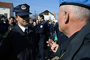 """SERB MEMBERS OF KPS SUSPENDED FOR UNDETERMINED PERIOD<br /> <br /> Gjilan, Graçanica, Kosovo<br /> Friday, February 29, 2008<br /> <br /> With the order of the Police MHQ in Pristina, on Friday, police members from the lines of Serb community from Gjilan region (eastern Kosovo) have been suspended; they don't recognize Albanian KPS (Kosovo Police Service) members order.<br /> Today also in Graçanica, a village populated with Serbs around 12 km far away from Pristina, KPS HQ (Kosovo police Service Headquarter) get information that than a group of Local Serbs members of KPS from Northern Police station, are attending to took under control Graçanica police station, as result to create another KPS institution only with Serbs and under control and role of law which came from Belgrade.<br /> Around more than 70 Serbs KPS members in Graçanica in charge of them chef Commander Stojan MILLOSHEVIÇ, all day of this Friday they decide to stay outside of police station in Graçanica, as them unhappiness expression against Kosovo Independence proclaimed on 17th February 2008.<br /> According to KPS HQ spokesman Agron BOROVCI,"""" KPS Serbs members can return to them positions of work, deadline is Saturday, March 1, 2008 until 12.00/pm, if they will not return back and recognize orders which came from HQ, they will be reject from KPS (Kosovo Police Service) says Borovci.<br /> Friday's situation in Graçanica has been monitored from many KFOR members and many civilian officers from Serbia, also for this situation most of citizens from Graçanica didn't care at all for this situation which came as result of Serbs KPS members.<br /> PICTURED: KPS Serbs Chef Commander Stojan MILLOSHEVIÇ on left, is negotiating with American UNMIK police Charles TELLER which is station operator chairman. Teller syas to Millosheviç that inside police station can com in only 3 serbs police officers, Millosheviç did not agree with that, he want to be inside only self tenth"""