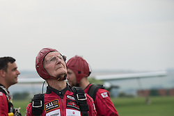 © Licensed to London News Pictures. 25/08/2016. <br /> <br /> Pictured: D-Day veteran Fred Glover looks up to the sky before his jump.<br /> <br />  Fred Glover and Ted Pieri, two D-Day veterans who are both 90 years old have parachuted into Sarum Airfield, Wiltshire on Thursday 25th August 2016, 72 years after D-Day having earlier in the month parachuted into Merville Battery in France.<br /> <br /> <br /> Photo credit should read Max Bryan/LNP