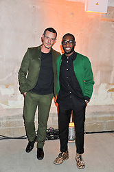 Left to right, JONATHAN SAUNDERS and TINIE TEMPAH at a dinner hosted by Jonathan Saunders, Fantastic Man & Selfridges to celebrate Jonathan Saunders AW13 Menswear collection and London Collections held at the Old Selfridges Hotel,  Orchard Street, London on 8th January 2013.