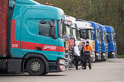 © Licensed to London News Pictures 22/12/2020.        Ashford, UK. Truckers at the truck stop. Hundreds of freight lorries and their drivers are stranded at Ashford International Truck Stop in Kent as France keep their borders closed due to fears over the new Cornavirus strain. Photo credit:Grant Falvey/LNP