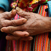 The hands of an elderly visitor to the Lung Khau Nhin Market. Vietnam. Lung Khau Nhin Market is rural tribal market hiding itself amongst the mountains and forests of the far north Vietnam about 10 km from the border with China. The market plays an important role for the local ethnic people, Flower Hmong, Black Zao, Zay, and very small ethnic groups  Pa Zi, Tou Zi, Tou Lao. Tourist trips to the market run from Sapa and Lao Cai every week. Lung Khau Nhin Market, Vietnam.15th March 2012. Photo Tim Clayton