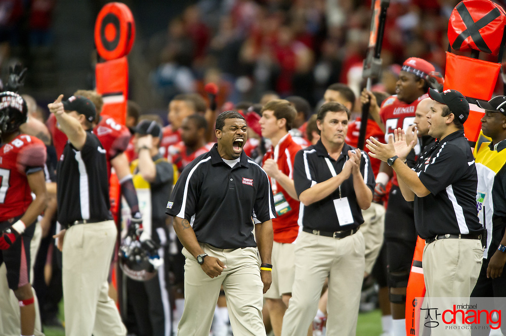 Louisiana-Lafayette's strength and conditioning coach, Derik Keyes reacts to a first down play during the R+L Carriers New Orleans Bowl at the Mercedes-Benz Superdome.  Louisiana-Lafayette defeated San-Diego State 32-30. (Copyright Michael Chang)