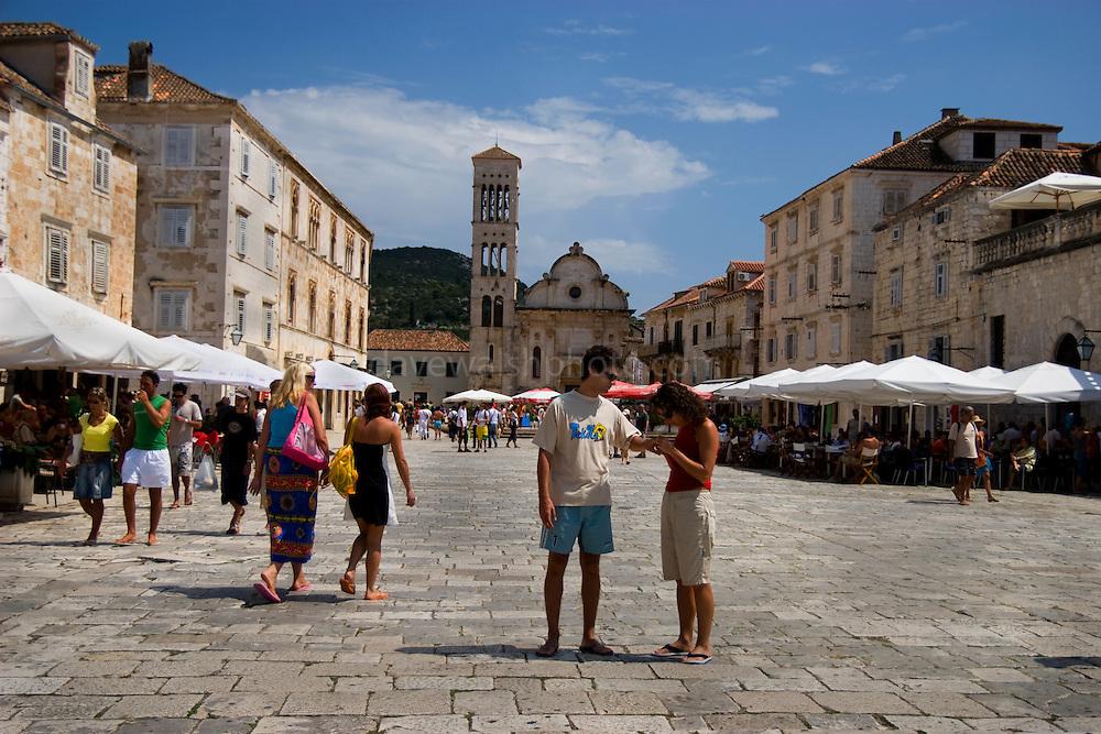 Young couple in Trg sv. Stjepana , main square, Hvar, Croatia