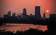 Sunset over the skyline of Pittsburgh, Pennsylvania. In the center is the Fort Pitt Bridge over the Monongahela River. USA.
