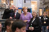 """19 SEP 2012, HAMBURG/GERMANY:<br /> Helmut Dosch, Vorsitzender DESY-Direktorium, Olaf Scholz, Erster Bürgermeister Hamburg, Angela Merkel, Bundeskanzlerin, Ada Yonath, Nobelpreisträgerin, Weizmann Institut of Science, (v.L.n.R.), besichtigen die PETRA III Experimentierhalle, Max von Laue-Fest """"Vorstoß in den Nanokosmos - Von Max Laue zu PETRA III"""" mit Taufakt der PETRA III-Experimentierhalle """"Max von Laue"""", mit Deutsches-Elektronen-Synchrotron, DESY<br /> IMAGE: 20120919-01-036"""