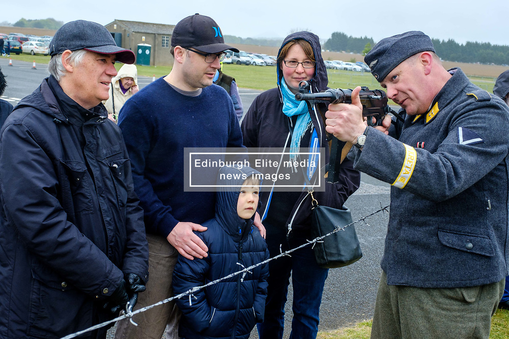 Sunday 7th May 2017 East Fortune:  Wartime Experience at the National Museum of Flight, East Fortune.  A reenactor explains the workings of a gun to the public.<br /> <br /> (c) Andrew Wilson | Edinburgh Elite media