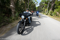 Bill Angel of Kernersville, NC riding his 2010 Custom Street Glide through Tamoka State Park during Daytona Beach Bike Week 2015. FL, USA. March 13, 2015.  Photography ©2015 Michael Lichter.