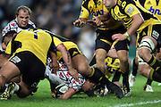 Luke Burgess is taken by John Schwalger. NSW Waratahs v Hurricanes. 2010 Super 14 Rugby Union round 14 match played at the Sydney Football Stadium, Moore Park Australia. Friday 14 May 2010. Photo: Clay Cross/PHOTOSPORT