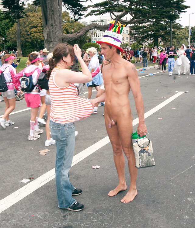 Unidentified woman pretending to be pregnant talks to naked man with cock ring at the 97th running of the Bay to Breakers 12K race, Sunday, May 18, 2008 in San Francisco. (Photo by D. Ross Cameron)