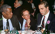U.S. Senator Sam Nunn a democrat from Georgia talks with Senator Paul Tsongas (right) and Atlanta businessman and insurance executive Jesse Hill (left) at a Georgia Democratic Party dinner