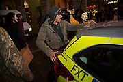 Protester pretends to have sex with a police car. 'F**k the police'. Bonfire night protest in central London by the activist group Anonymous, in a demonstration called the Million Mask March. Masked protesters created havoc as they marched on Parliament, and all over central London. The protest, which was organised in hundreds of cities, is said to be against austerity and infringement of human rights.