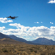 A United States Air Force C130 performs touch and go exercises at the Mammoth Yosemite Airport.