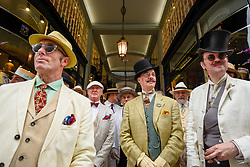 © Licensed to London News Pictures. 14/07/2019. LONDON, UK.  London, UK. 14 July 2019.   Elegantly dressed people take part in The Grand Flâneur walk.  Starting at the Beau Brummell statue on Jermyn Street, the walk coincides with the 20th anniversary of The Chap magazine and is defined as a walk without purpose, celebrating the art of the flâneur, oblivious to going anywhere specific, and an antidote to the demands of modern life and the digital smartphone.  Similar walks are taking place in Dusseldorf and Los Angeles.  Photo credit: Stephen Chung/LNP