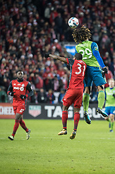 December 9, 2017 - Toronto, Ontario, Canada - Seattle Sounders defender ROMAN TORRES (29) heads the ball over Toronto FC defender BRANDON AUBREY (32) while Toronto FC forward JOZY ALTIDORE (17) looks on during the MLS Cup championship match at BMO Field in Toronto, Canada.  Toronto FC defeats Seattle Sounders 2 to 0. (Credit Image: © Mark Smith via ZUMA Wire)