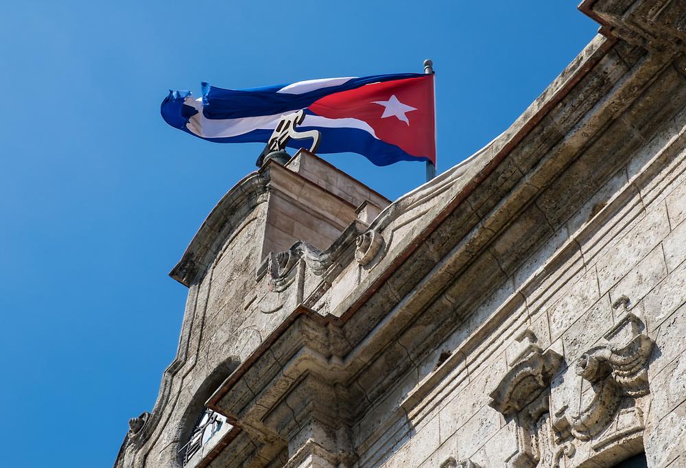 """HAVANA, CUBA - CIRCA MAY 2016: Cuban Flag over the """"Palacio De los Capitanes Generales"""" in Havana."""