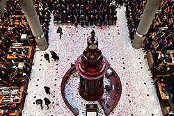 The floor of the Lloyd's building is covered in poppies after they were dropped through the atrium during the Lloyd's of London Armistice commemoration service.