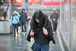 © Licensed to London News Pictures . 26/12/2015 . Manchester , UK . A woman walks through the rain in Manchester this morning (26th December 2015) . Photo credit: Joel Goodman/LNP