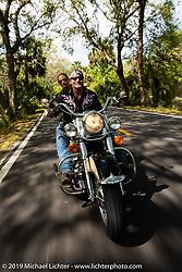 Jay Allen riding his Shovelhead with Danielle VanDeventer through Tomoka State Park during Daytona Bike Week. FL. USA. Sunday March 18, 2018. Photography ©2018 Michael Lichter.