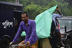 August 16, 2017 - Dhaka, Bangladesh - Bangladesh rickshaw drives with passenger on the street during rainy day in Dhaka, Bangladesh. On August 16, 2017. (Credit Image: © Str/NurPhoto via ZUMA Press)