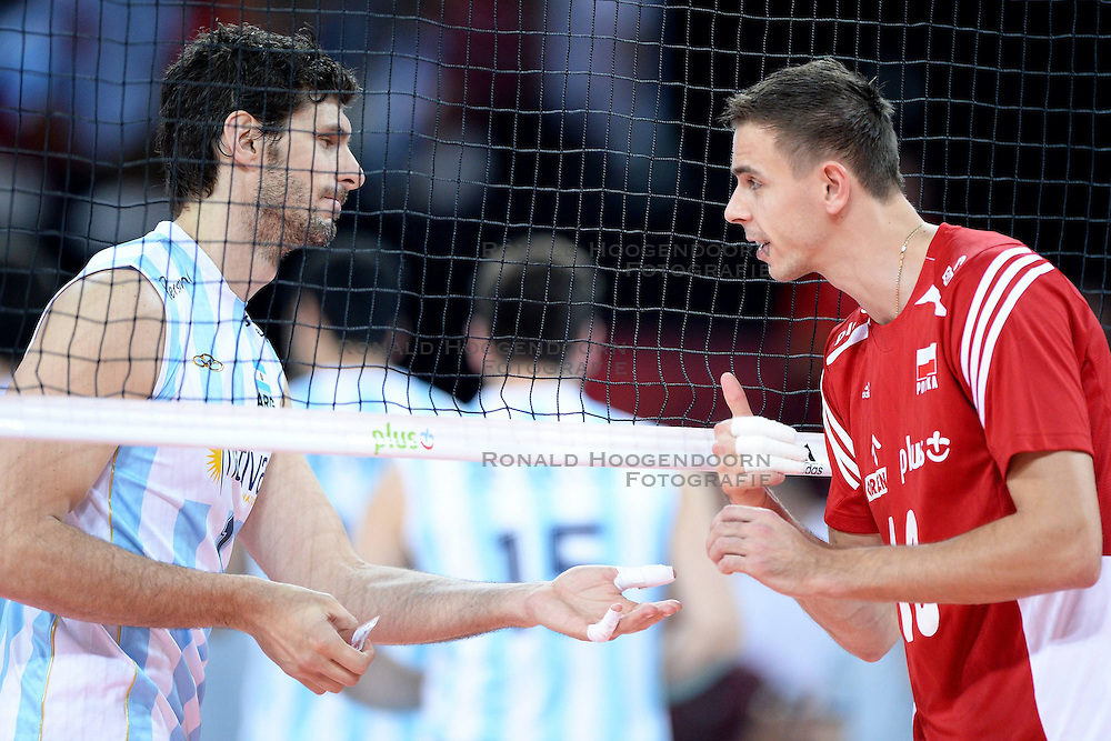 07.09.2014, Centennial Hall, Breslau, POL, FIVB WM, Polen vs Argentinien, Gruppe A, im Bild MARIUSZ WLAZLY, PRZED MECZEM WYMIANA // during the FIVB Volleyball Men's World Championships Pool A Match beween Poland and Argentina at the Centennial Hall in Breslau, Poland on 2014/09/07. <br /> <br /> ***NETHERLANDS ONLY***